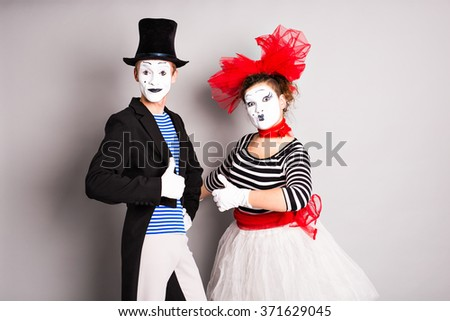 Portrait of a two happy mimes comedian showing thumbs up, April Fools Day concept - stock photo