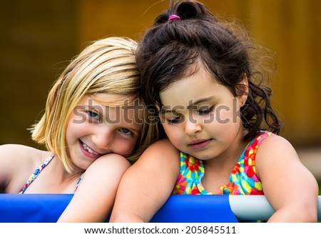 Portrait of a two little girls playing outdoor