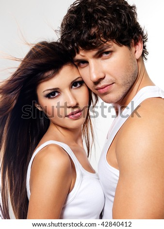 Portrait of a two sexuality beautiful lovers posing at studio - stock photo