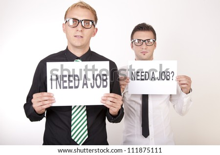 Portrait of a two young men holding signs need a job. - stock photo