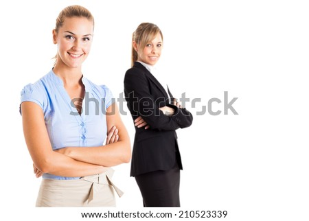 Portrait of a two young smiling women. Isolated on white - stock photo