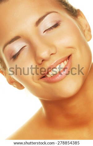 Portrait of a unblemished beauty giving you a big smile - Isolated on white - stock photo