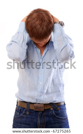 Portrait of a unhappy young businessman isolated over white - stock photo
