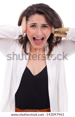 Portrait of a unhappy young woman covering her ears and screaming. - stock photo