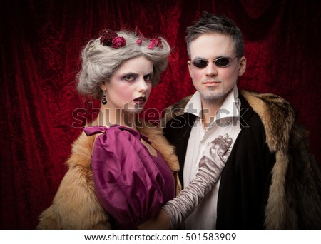 Portrait of a vampire family over red vintage background