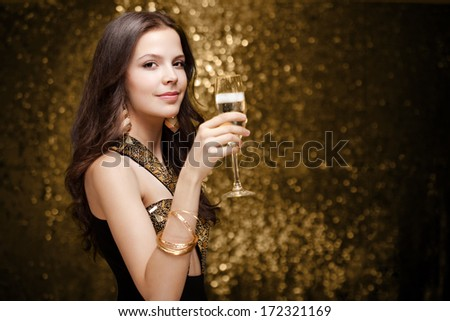 Portrait of a very fashionable, cool and elegant festive young woman. - stock photo