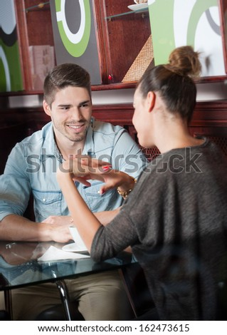 Portrait of a very fashionable young couple having fun in the city. - stock photo