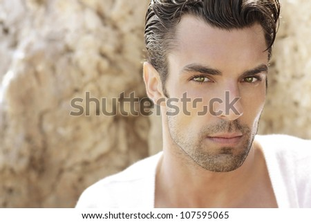 Portrait of a very handsome young man - stock photo