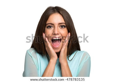 Portrait of a very happy and surprised woman. Isolated on white