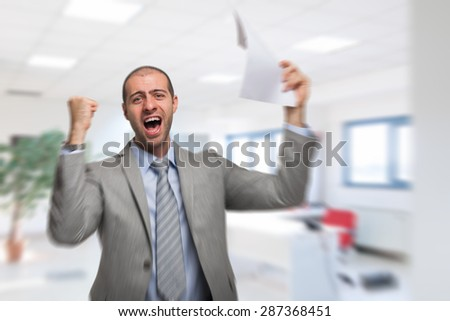 Portrait of a very happy business man - stock photo