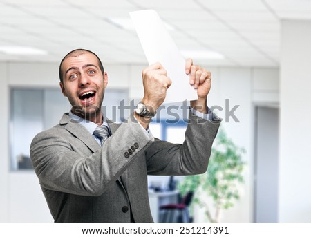Portrait of a very happy business man holding a document - stock photo