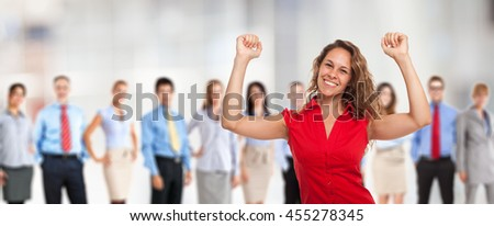 Portrait of a very happy woman in front of a group of people - stock photo