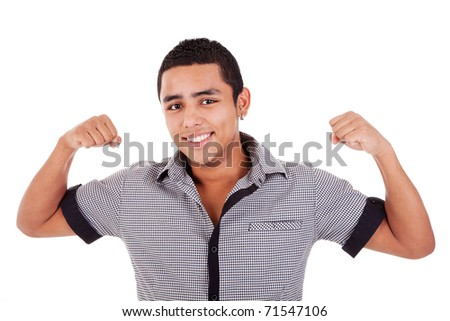Portrait of a very happy  young latin man with his arms raised, on white background. Studio shot - stock photo