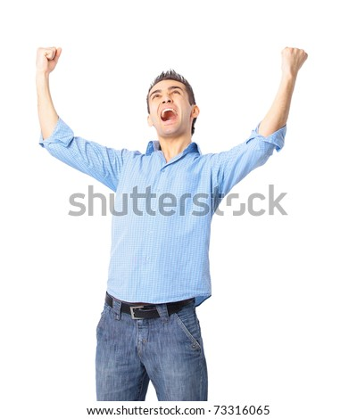 Portrait of a very happy young man with his arms raised - stock photo