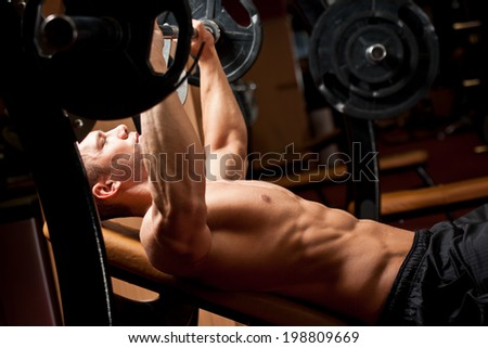 Portrait of a very muscular ripped fit young man. - stock photo
