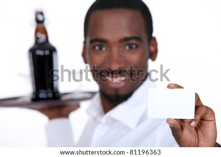 portrait of a waiter - stock photo
