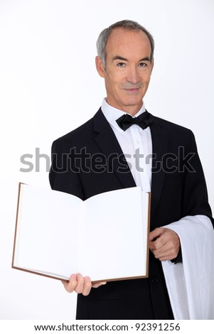 portrait of a waiter - stock photo