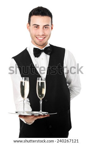 Portrait of a waiter holding champagne glasses isolated on white - stock photo