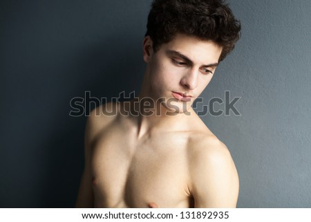 Portrait of a well built shirtless muscular male model - stock photo