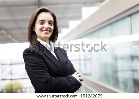 Portrait of a well-dressed young business woman with cross-armed