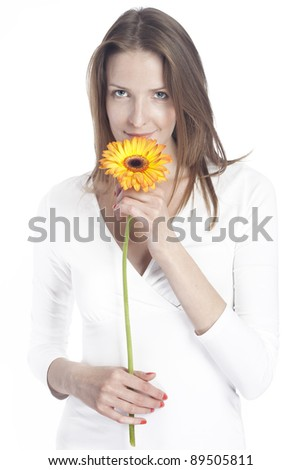 Portrait of a white woman with orange flower - stock photo