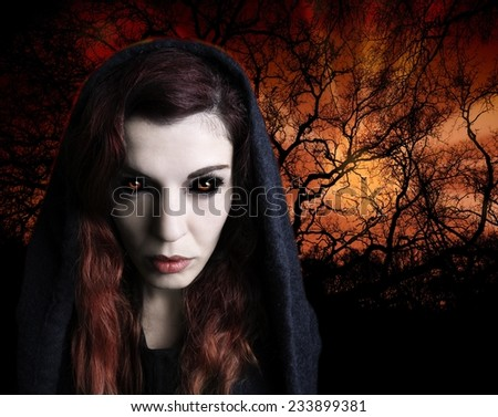 Portrait of a witch with scary eyes - stock photo
