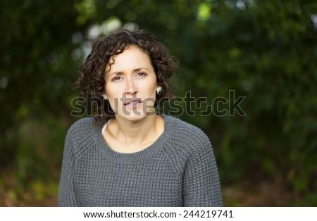 Portrait Of A Woman Afraid - stock photo
