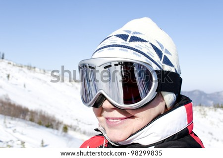 Portrait of a woman alpine skier in the lift - stock photo