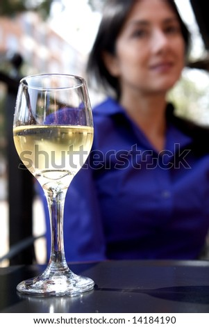 Portrait of a woman and a glass of champagne - stock photo