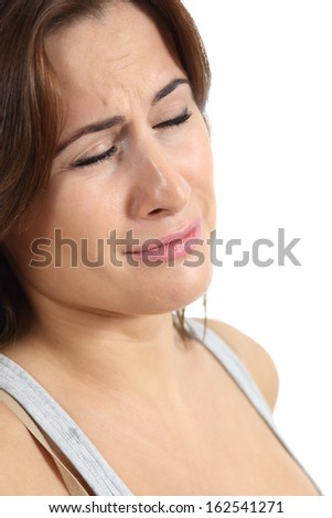 Portrait of a woman crying in tears isolated on a white background - stock photo