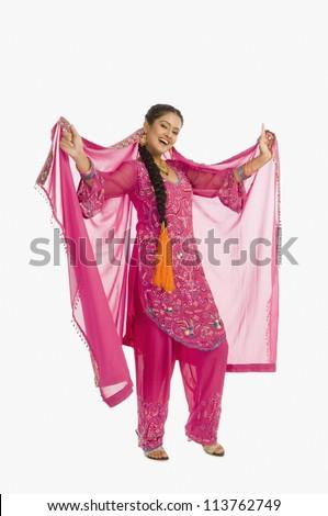 Portrait of a woman dancing in salwar kameez - stock photo