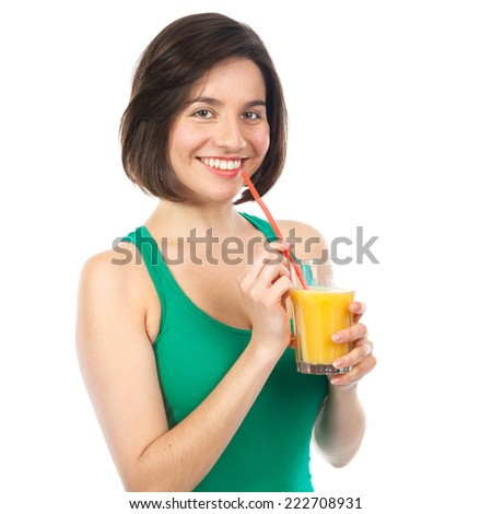 Portrait of a woman drinking an orange juice with a straw, isolated on white - stock photo