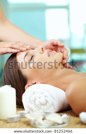 Portrait of a woman enjoying facial