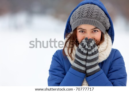 Portrait of a woman feeling cold in winter ? outdoors - stock photo
