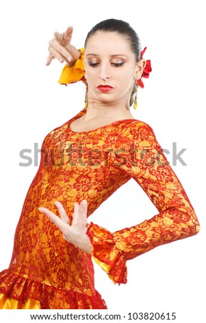 Portrait of a woman flamenco dancer wearing orange and yellow dress, looking down at her hand  - isolated on white