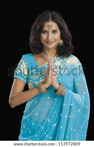 Portrait of a woman greeting - stock photo