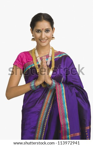 Portrait of a woman greeting in prayer position - stock photo