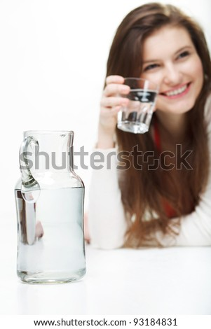 Portrait of a woman holding a glass of water - stock photo