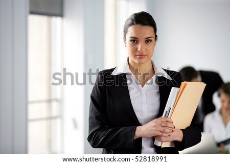 Portrait of a woman holding documents - stock photo