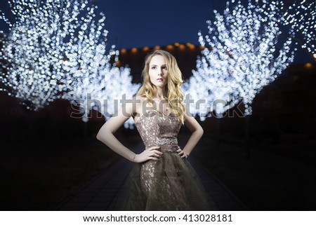 Portrait of a woman in a beautiful dress with flower pattern in nature