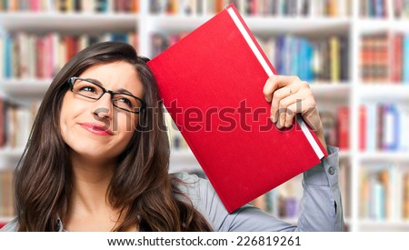 Portrait of a woman in a library - stock photo