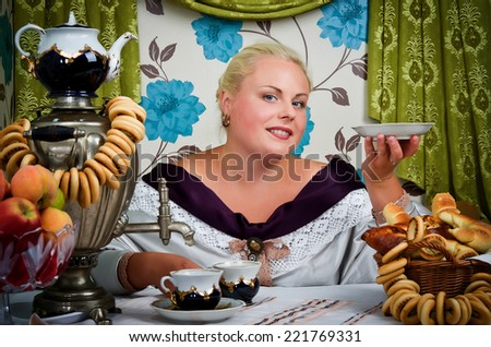 Portrait of a woman in a retro style. Lady drinking tea from a samovar, eating homemade cakes - stock photo