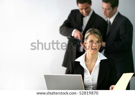 Portrait of a woman in front of a laptop computer - stock photo