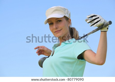 portrait of a woman in golf clothes - stock photo
