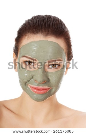 Portrait of a woman in green face mask.
