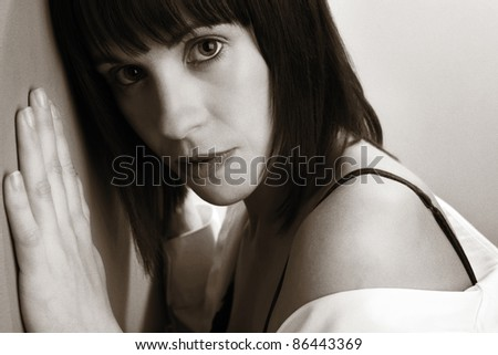 portrait of a woman in her underwear also wearing a mans shirt - stock photo