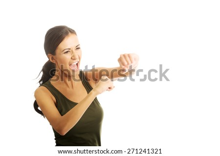 Portrait of a woman in military clothes boxing to the camera. - stock photo
