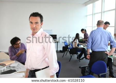 Portrait of a woman in office - stock photo