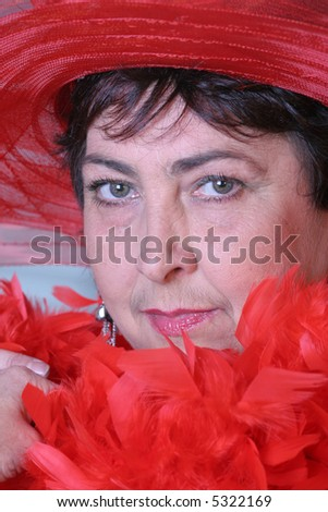 portrait of a woman in red hat - stock photo