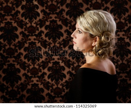 Portrait of a woman in 30's or 40's side view - stock photo